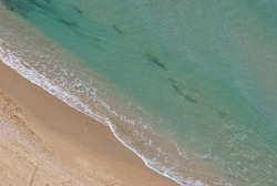 Beautiful seashore in summer. Calm blue sea landscape. Stony and sandy seashore.  Sunny seascape. Netanya city, Israel