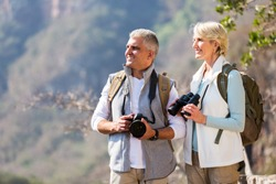 beautiful senior hikers enjoying outdoor activity