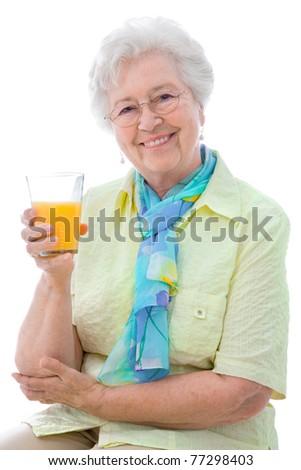 beautiful senior woman  enjoying a glass of orange juice