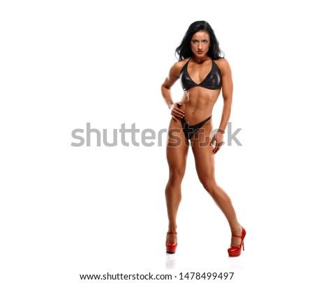Beautiful Sensual Fit Woman in Bikini and Red High Heels
