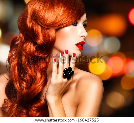 Beautiful sensual woman with long red hairs and red nails -   over art blink night lights