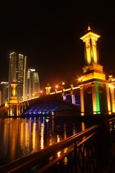 Beautiful Seri Gemilang Bridge located in Putrajaya with colorful reflection