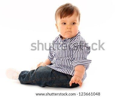 743b449c53d Beautiful serious little boy in jeans isolated over white background  #123661048