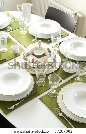 beautiful served table with green napkins