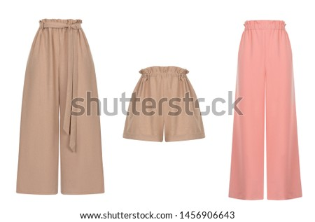 Beautiful set of women's clothes, loose brown pants and shorts with a belt and pink long pants, front view, ghost mannequin, isolated on white background, clipping Stockfoto ©