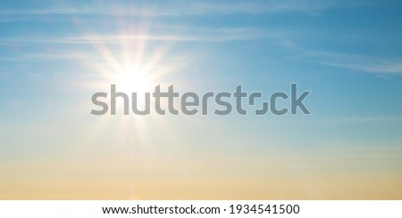 beautiful setting sun and blue sky with copy space.