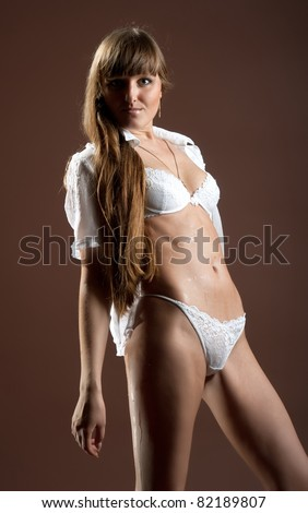 Beautiful sexual girl brunette pose on brown background