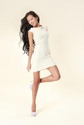 Beautiful sexy asian woman in stylish white dress.  Studio shot