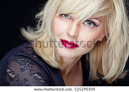 Beautiful Sexy Blond Girl. Blonde isolated on a Black Background