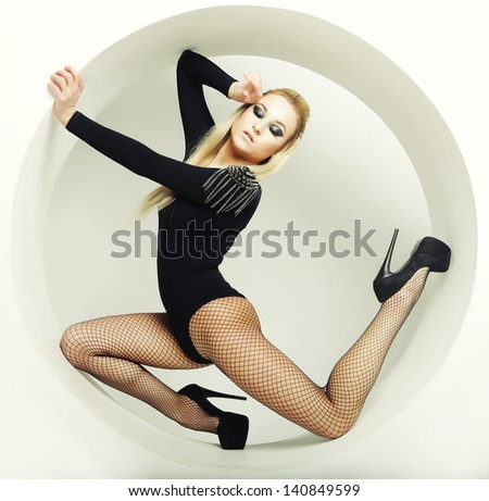 beautiful sexy blond woman posing in circle