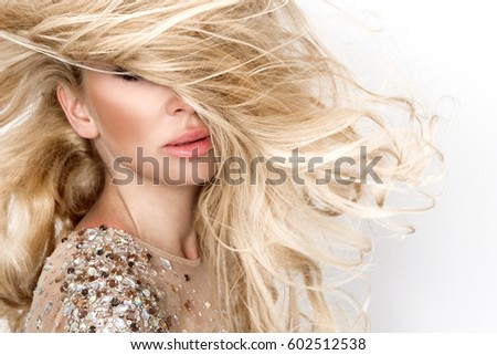 Beautiful sexy blonde female model with amazing long  hair and perfect face posing on a white background #602512538