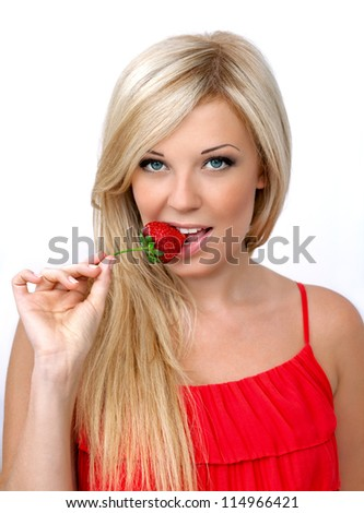 beautiful sexy blonde girl with a chic hair with ripe red strawberry