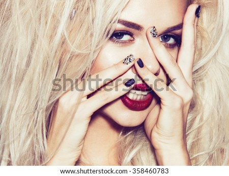 Beautiful sexy blonde girl with sensual lips, fashion hair, black nails. Beauty face. Instagram filters. Picture taken in the studio