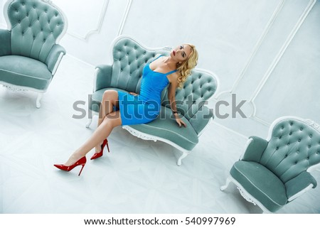 Beautiful sexy blonde posing indoors with a beautiful interior #540997969