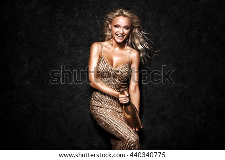 Beautiful sexy blonde woman on black background, party.