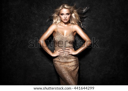 Beautiful sexy blonde woman on black background, party. #441644299