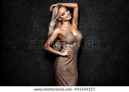 Beautiful sexy blonde woman on black background, party. #441644311