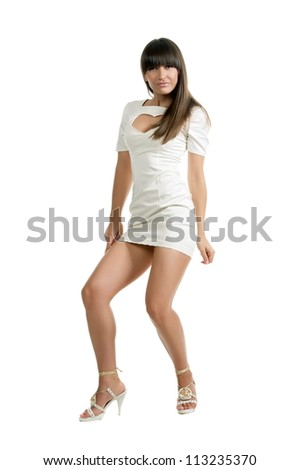 Beautiful sexy brunette girl posing on a white background
