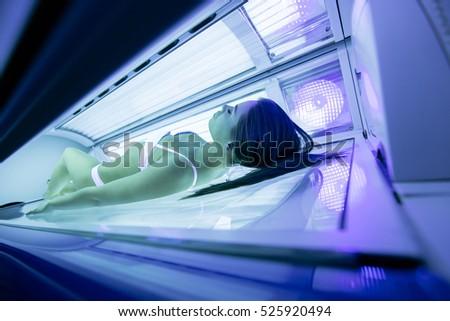Beautiful sexy  brunette sunbathing in solarium #525920494