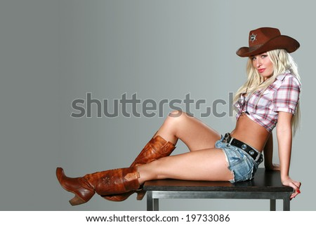 Beautiful sexy Cowgirl in cowboy hat