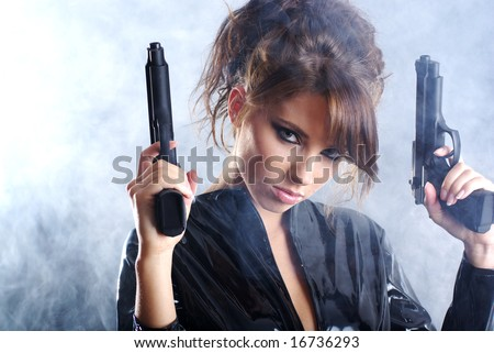 beautiful sexy girl  holding gun . smoke background - stock photo