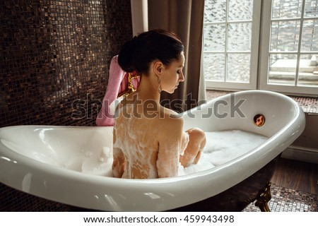 Sexy girls taking a bath