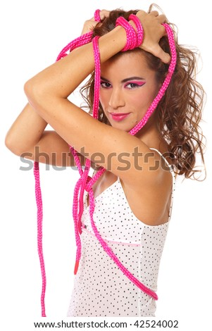 Beautiful sexy girl tied with pink rope, on white background