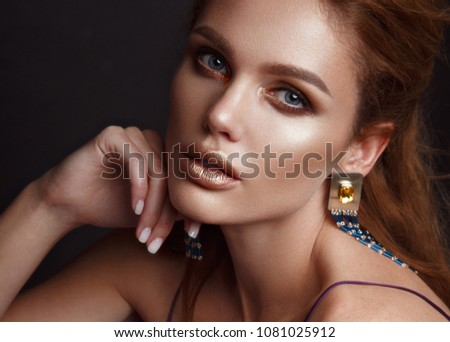 Beautiful sexy girl with sensual lips, fashion hair,purple dress and accessories. Beauty face. Picture taken in the studio