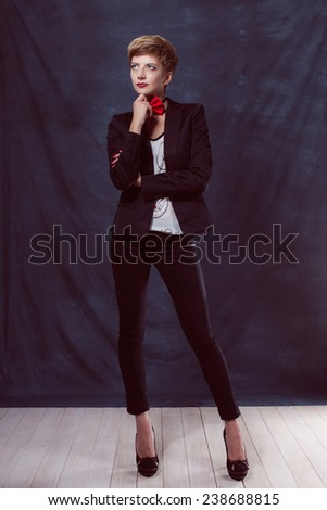 beautiful sexy girl woman in a suit with a bow tie shoes success thoughtful look smile