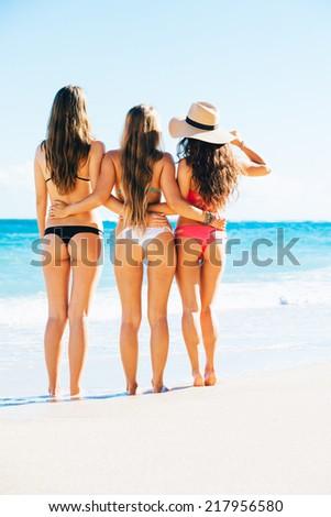 Beautiful Sexy Girls in Bikinis on Tropical Sunny Beach