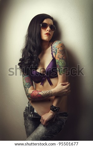 Beautiful sexy glamorous girl with tattoos. I removed the trademark from the glasses.