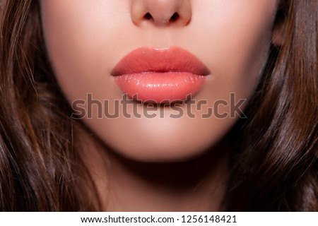 beautiful sexy lips. plump female lips with make-up - peach gloss lipstick. natural lips. beige color - Image              #1256148421