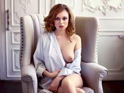 Beautiful sexy redhair woman in white shirt