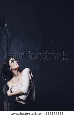 beautiful sexy woman against dark background