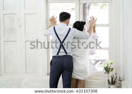 Beautiful sexy woman and boyfriend hug. Romantic couple dating at home.