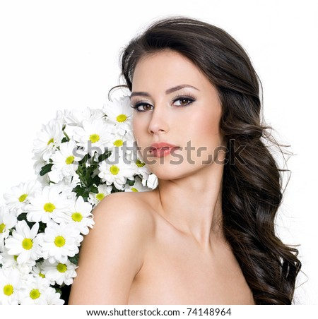 Beautiful sexy woman and white flowers near her body - white background