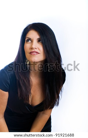 Beautiful, sexy woman in her 40s wearing a cute black cocktail dress.