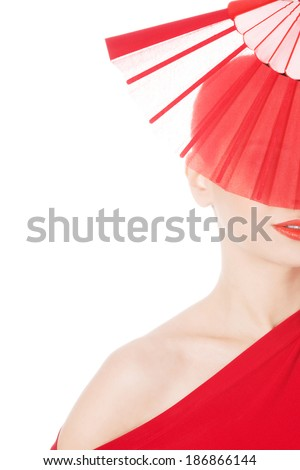 Beautiful sexy woman in red dress and fan. On white background.