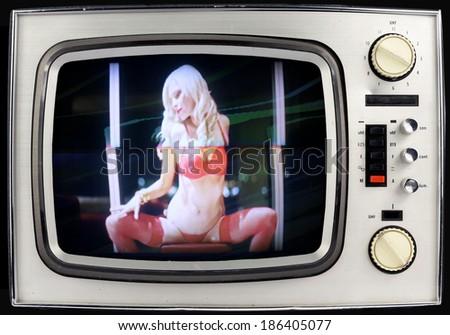 beautiful sexy woman in red lingerie dancing stuck inside retro televison