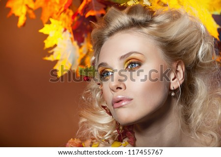 Beautiful, sexy woman in the image of autumn