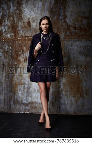 Beautiful sexy woman lady wear casual style outerwear wool cashmere coat trench black color skirt pretty face dark natural hair winter fall collection glamour model fashion clothes background studio. #767635516