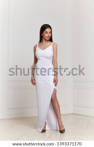 Beautiful sexy woman makeup wear fashion summer collection clothes casual style party office dress code slim body pretty face model pose accessory jewelry brunette hair interior room white wall bride.