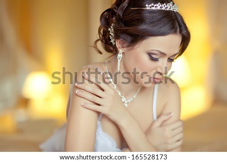 Beautiful sexy woman morning bed, alluring girl in underwear lingerie, sensual brunette woman beauty. Gorgeous bride have final preparation for wedding. Bride morning. Attractive rich bride wedding