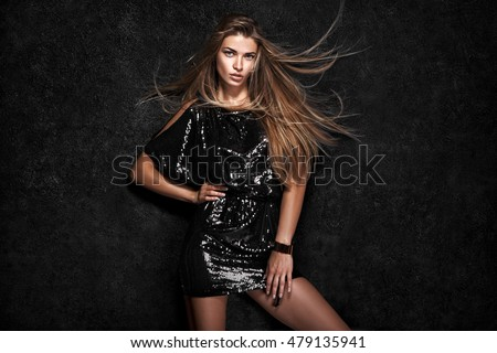 Beautiful sexy woman on black background