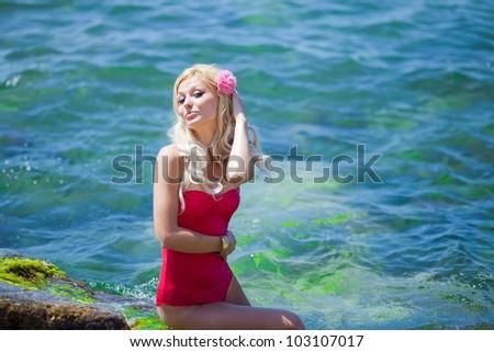 Beautiful sexy woman on the seashore