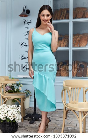 Beautiful sexy woman wear fashion summer collection clothes casual style blue cotton dress slim body pretty face model pose accessory jewelry brunette hair bread shop cafe breakfast morning coffee. #1393371092