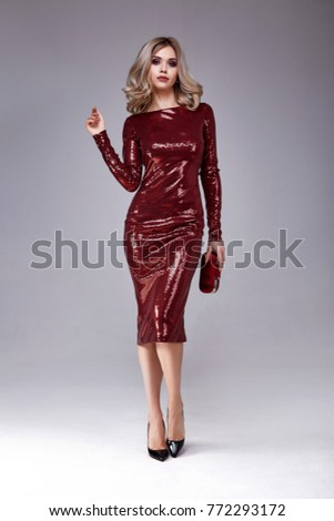 Beautiful sexy woman wear lux skinny shine red dress shiny sequins style for party celebrate New Year Christmas beauty salon hair style makeup perfect body shape jewelry model pose fashion clothes. #772293172