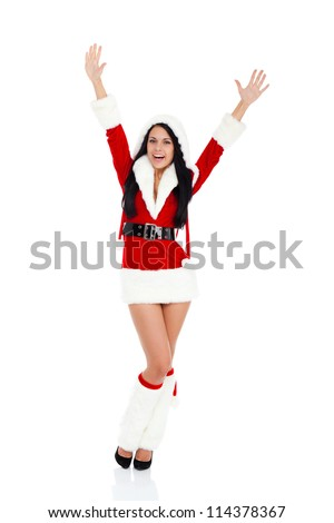 Beautiful sexy woman wear Santa Clause costume, christmas new year party girl excited happy smile holding arms and hands up posing full length portrait isolated on white background