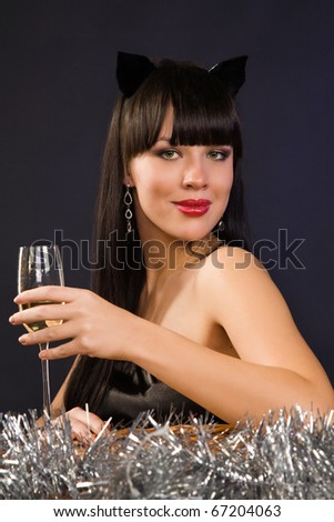 Beautiful sexy woman wearing cat clothes with a wine glass