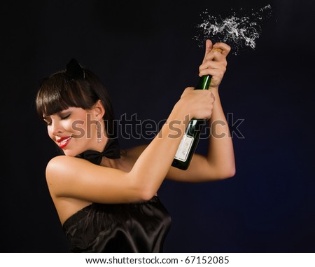 Beautiful sexy woman with a champagne bottle